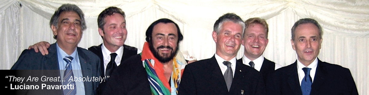 Pavarotti posing with performers and spectators