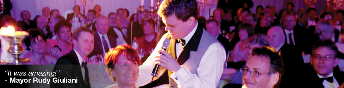 Waiter singing on a corporate event, woman spectator smiling